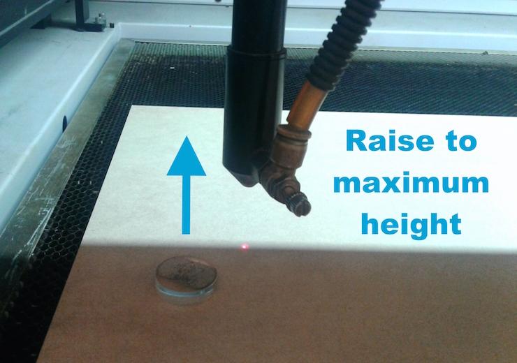 LaserCuttingMachine_Calibrating raising the laser