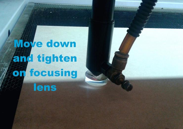 LaserCuttingMachine focusing the laser cutter